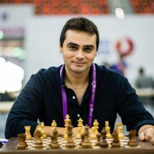Ntirlis nikolaos is sitting in front of a chess board